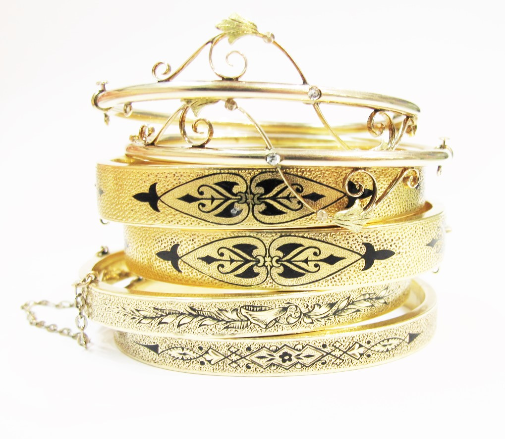 Three sets of nineteenth-century bangles in 14k yellow gold, all available at 灰色& Davis.