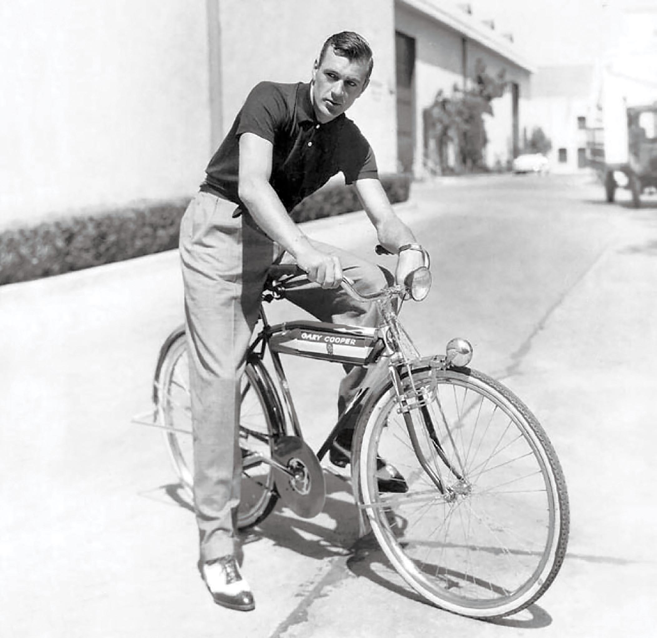 Gary Cooper hops on his bicycle