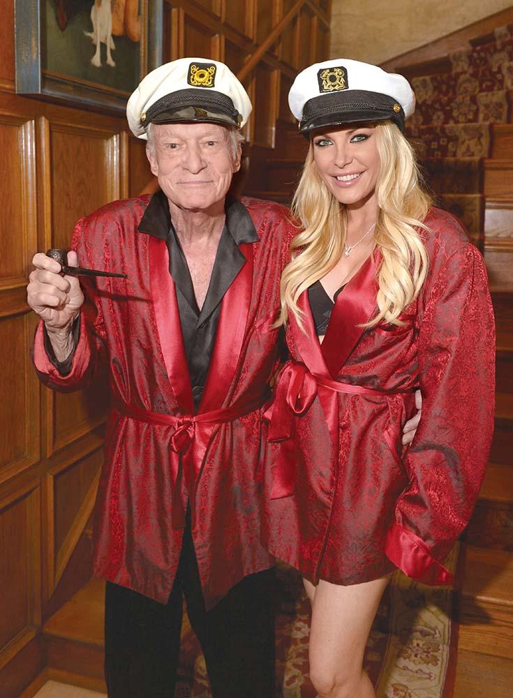 Hugh Hefner and Crystal Hefner attend the Playboy Mansion's annual Halloween Bash on October 25, 2014 in Los Angeles