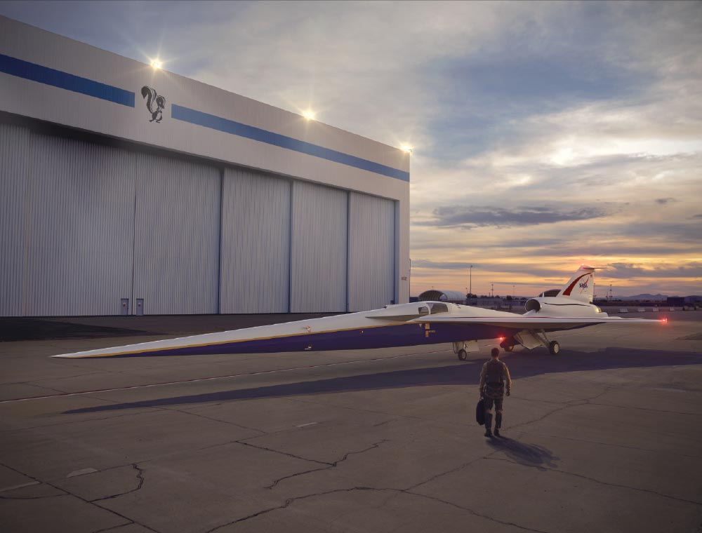 Artist's concept of the Low-Boom Flight Demonstrator parked outside Lockheed Martin Aeronautics' Skunk Works hangar in Palmdale, California