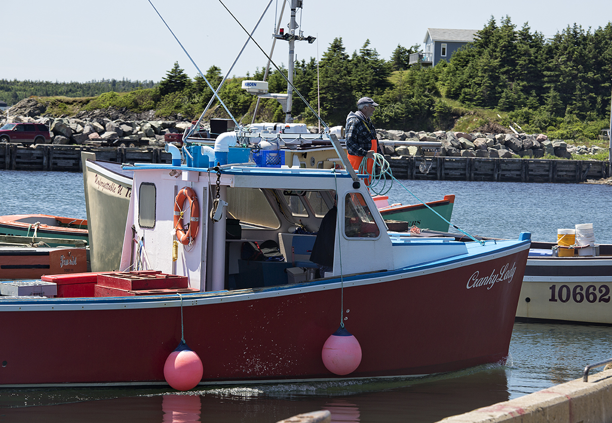 The Cranky Lady comes into port with all its lobsters from the day. Main a Dieu, Cape Breton.