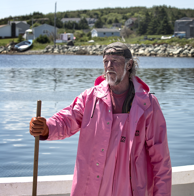 This is one confident lobsterman, wearing pink. Main a Dieu, Cape Breton