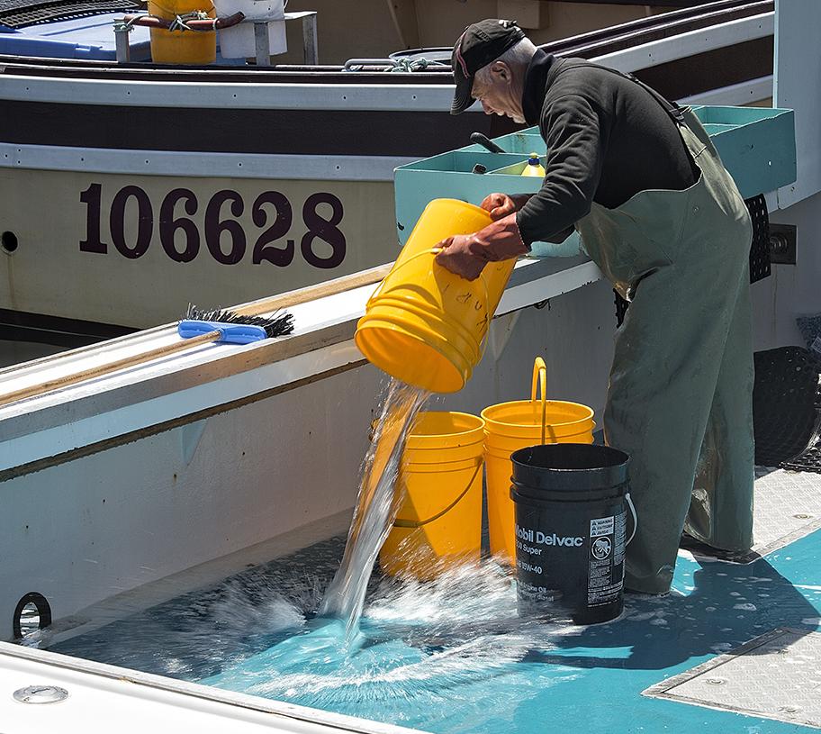 Cleaning the boat in Main a Dieu, Cape Breton.