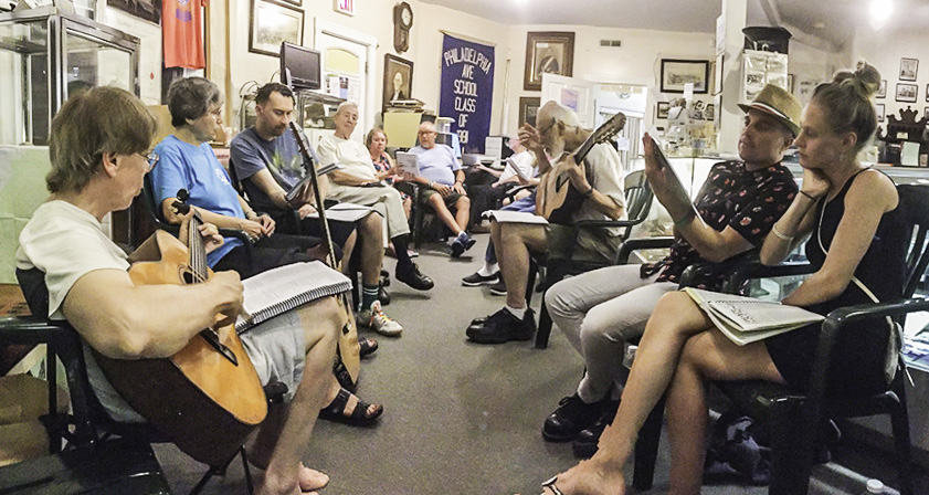 Musicians lead a sing-along of peace songs