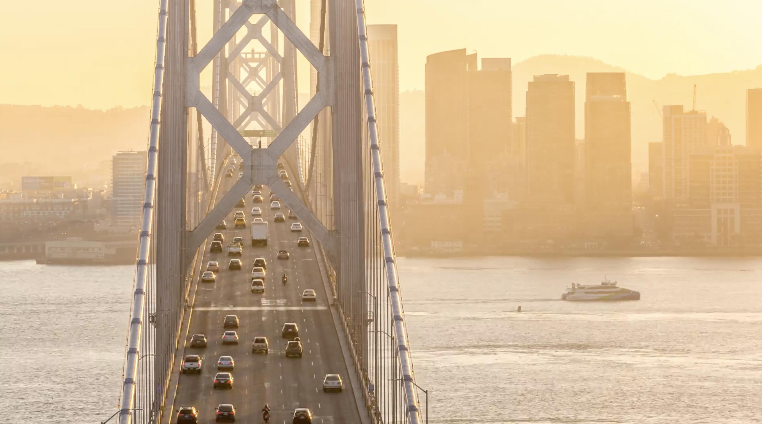 HD) Downtown San Francisco and Bay Bridge at Golden Hour