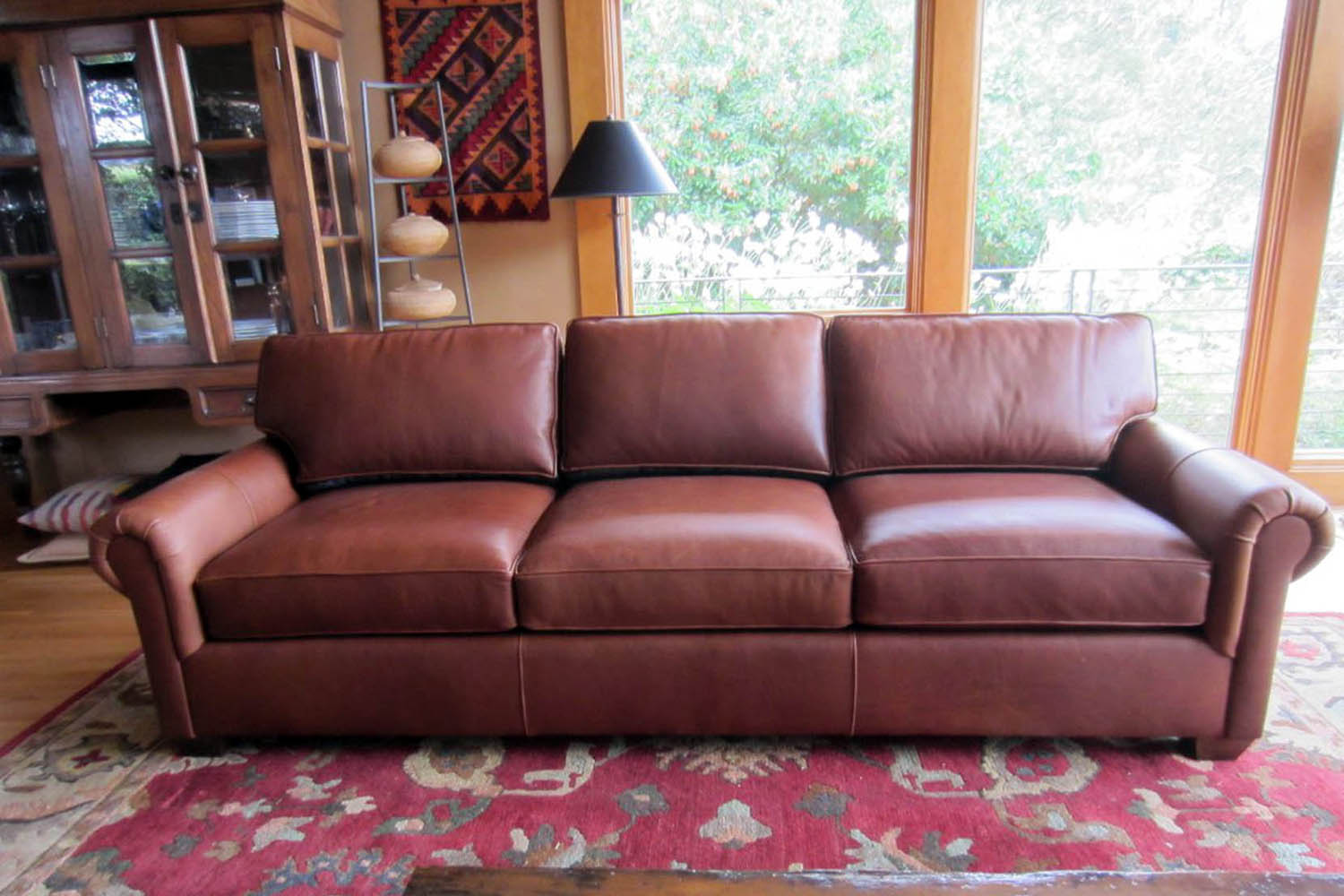 Casters Style Leather Sofa