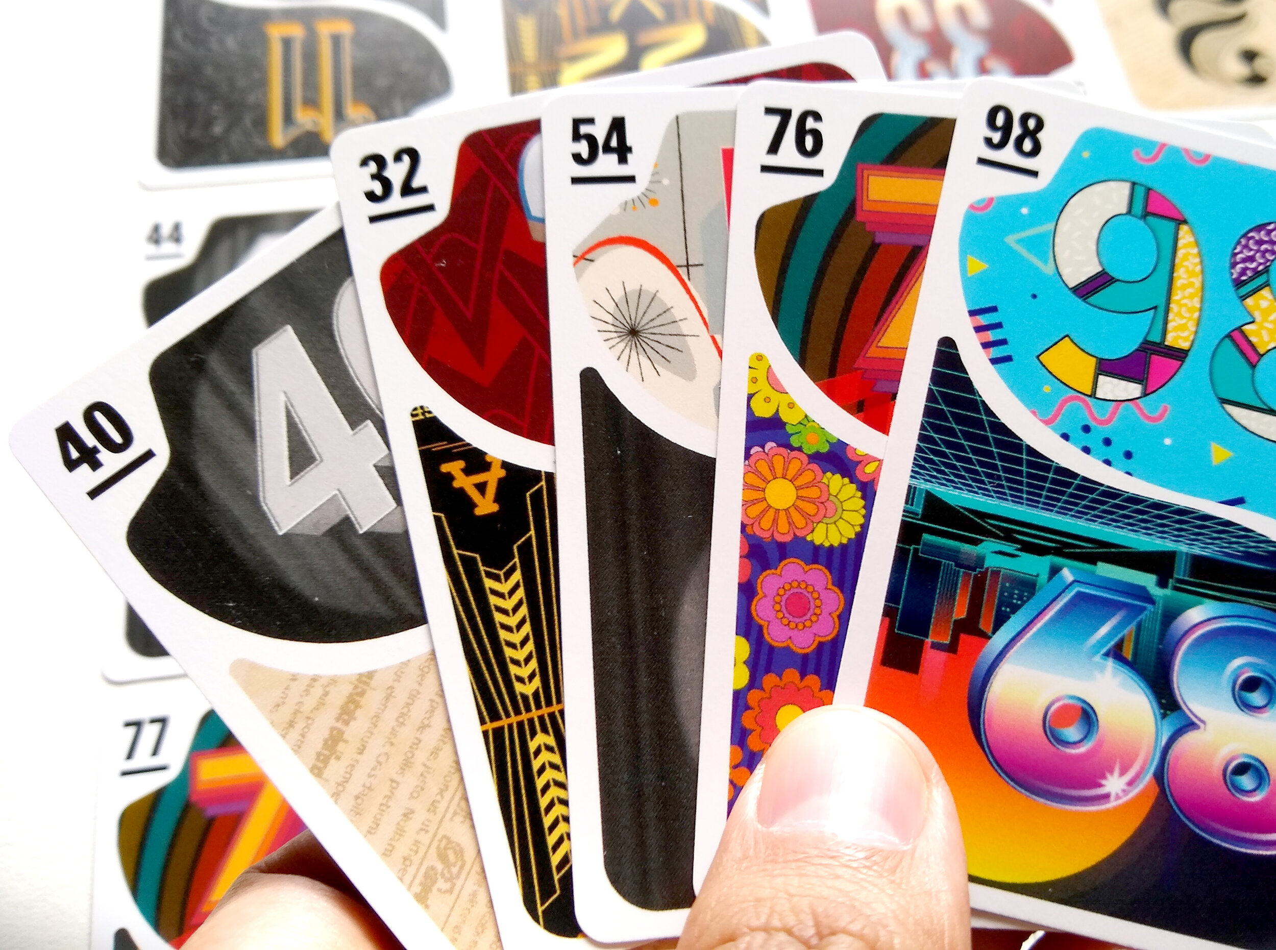 Close-up of a hand of mirror deck cards