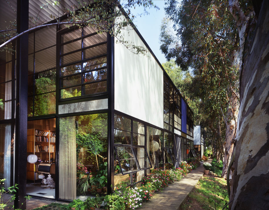 Exterior of the Eames House nestled above the meadow
