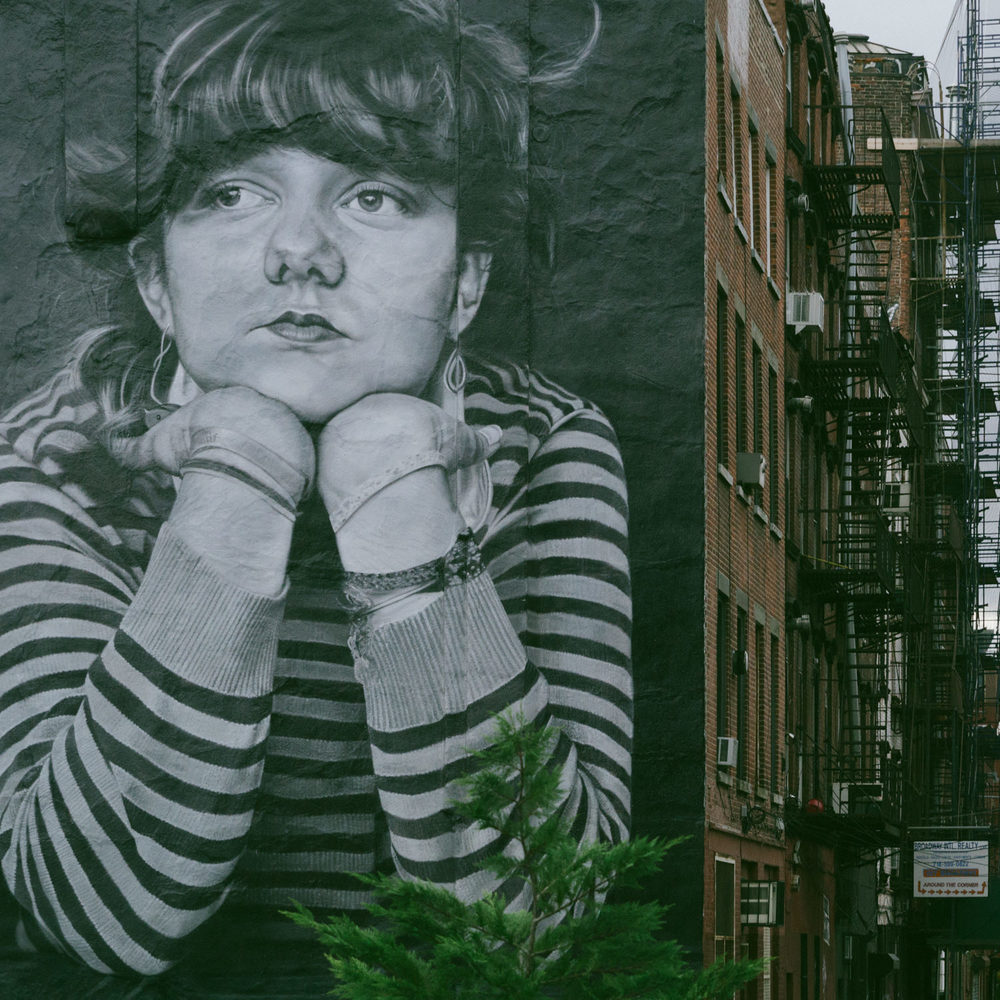 A mural painted on the side of a building on the Brooklyn side of The Williamsburg Bridge