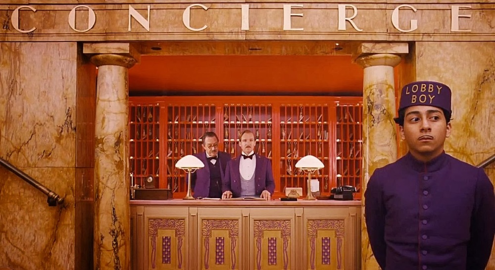 The concierge desk at The Grand Budapest Hotel / Fox Searchlight Pictures
