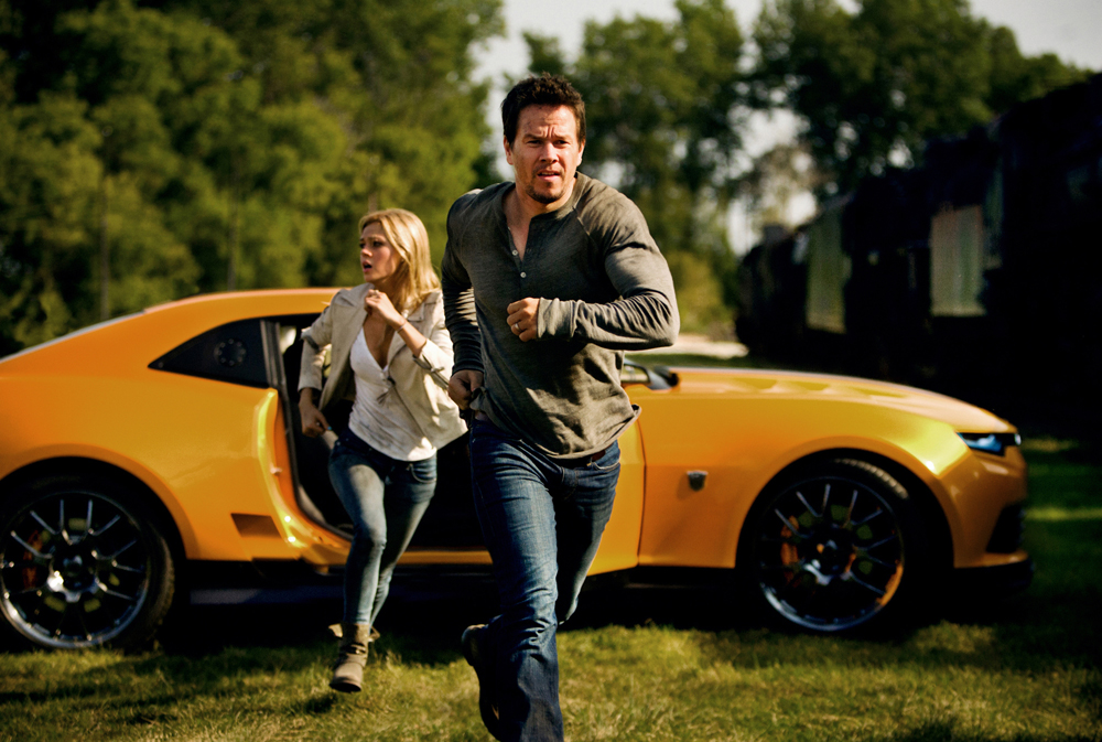 Cade (Mark Wahlberg) and his daughter Tessa (Nicola Peltz) in Transformers: Age of Extinction / via Paramount