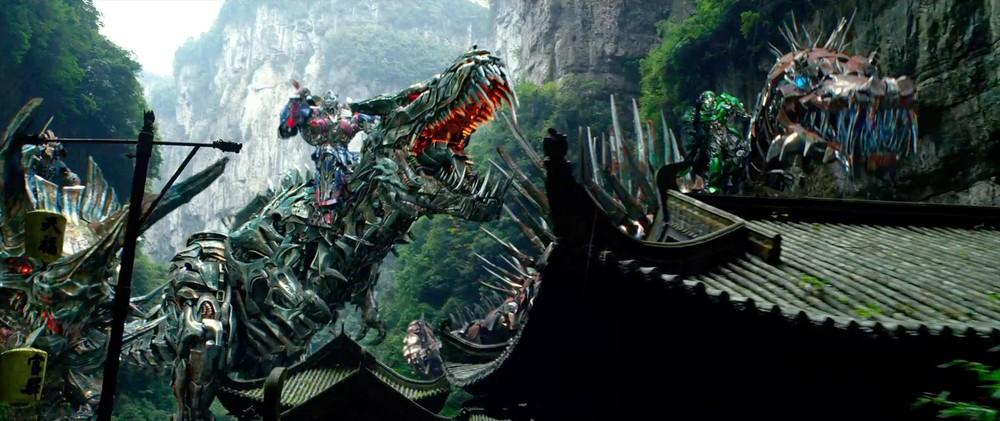 Optimus Prime rides Dinobot Grimlock in Transformers: Age of Extinction / via Paramount