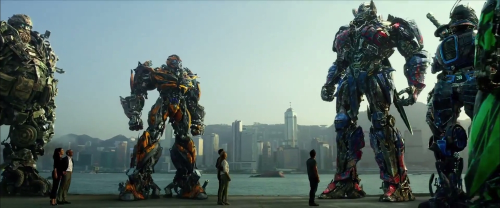 Autobots and humans standing together in Transformers: Age of Extinction / via Paramount