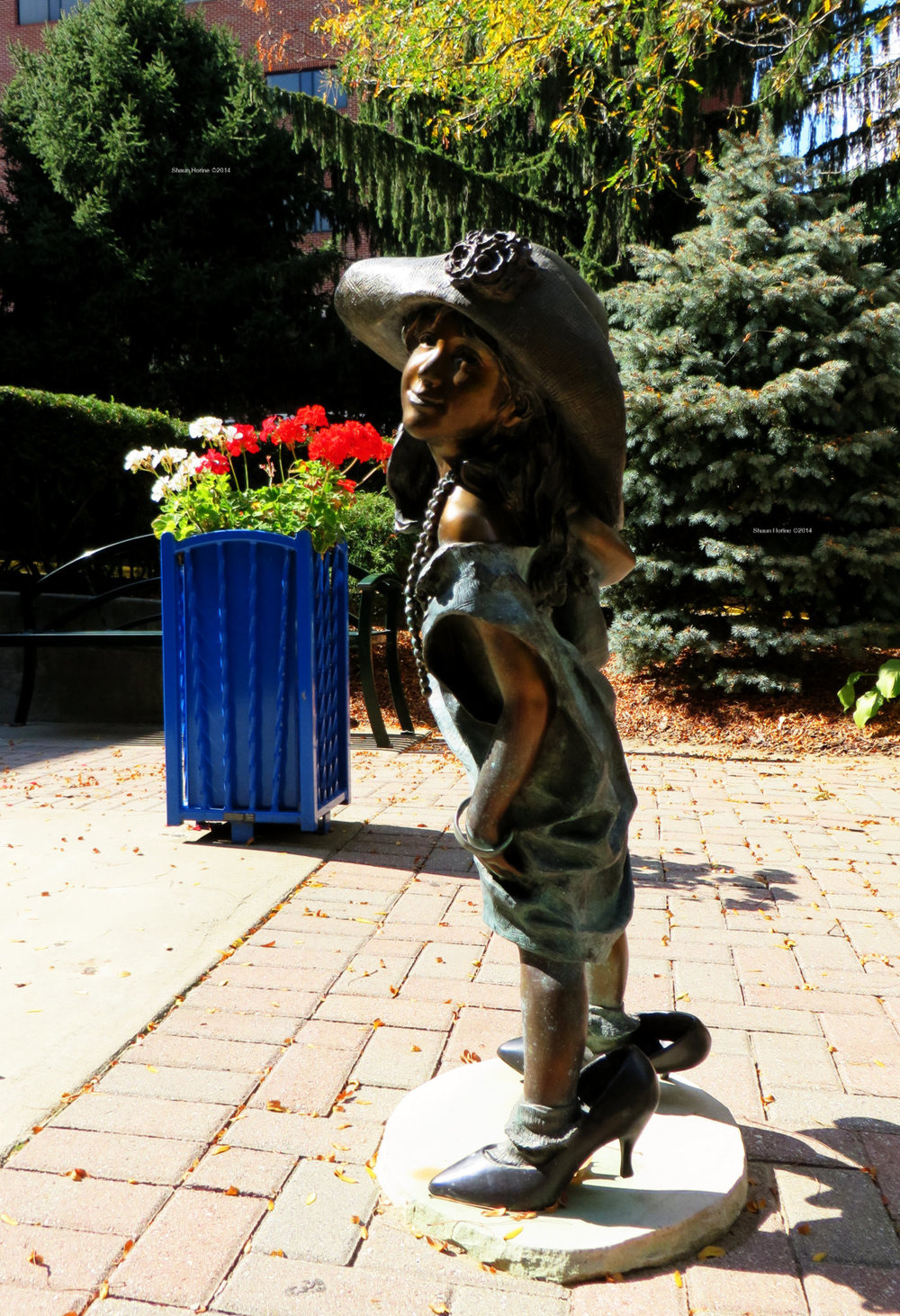 Front view of small girl statue. Baptist Health Lexington, KY. Canon SX280 HS