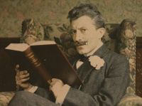 A man reading business and marketing books.