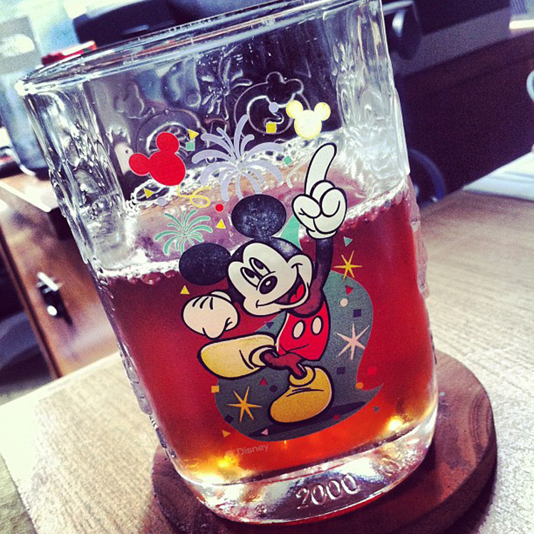 """Afternoon iced tea in a Micky Mouse glass"" by C.C. Chapman"