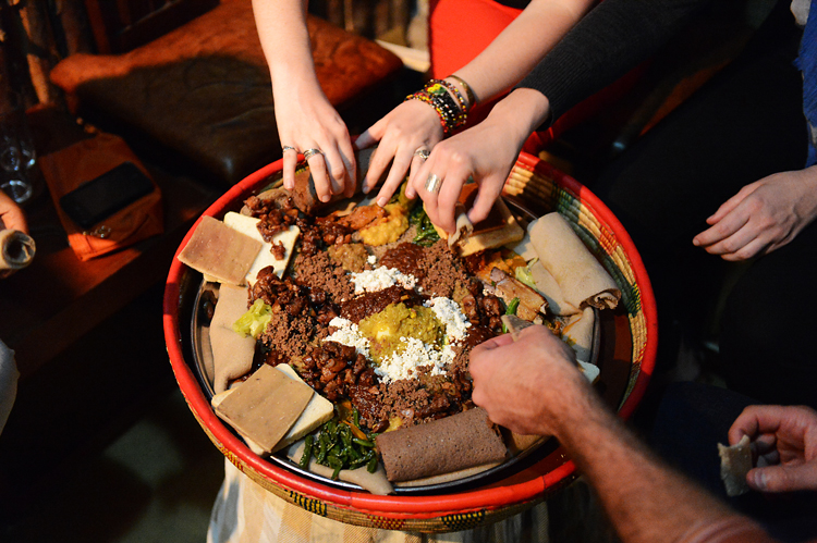 At the end of our first day, we shared a traditional Ethiopian meal.  Ethiopian food is meaty, spicy, shared communally, and there aren't any utensils; you eat with your hands.There's something very intimate about sharing a meal this way, i think.  It feels like a wonderful way to seal new friendships.