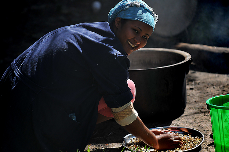 This is Saba, one of the women who works at FashionABLE.  Here's she's preparing coffee beans for roasting, for a coffee ceremony. Saba also has one of the FashionABLE scarves named after her, and she shared her story of how she ended up on the streets, but more importantly, how she's now making a sustainable living off the streets -- and taking care of her mother, in the process.  A radiant woman.