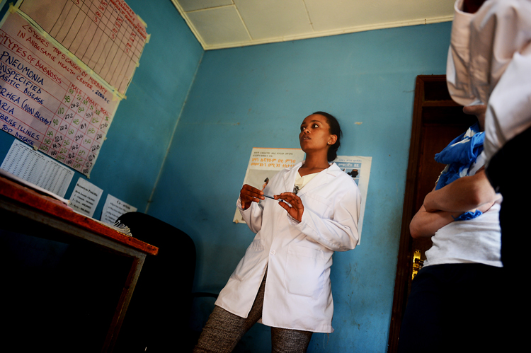 A midwife at a rural clinic outside of Addis Ababa explains the conditions she is sometimes faced with in her job. Although I was permitted to take photographs at this clinic, I chose not to -- I couldn't imagine being at a hospital feeling ill, and a photographer coming up with a camera in my face asking to take my picture.  So for the most part, I put the camera away.  But I did like the angle that this was shot, and since there were no patients in the frame,  I thought I'd share it.