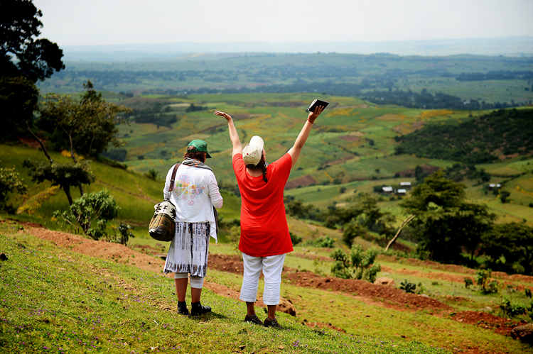 Cathleen Falsani and Kelly Wickham taking in the gorgeous Ethiopia countryside, as we waited for the beekeepers to return with their beehives.  Kelly's gesture represents what I think we were all feeling as we looked out at the scenery before us.