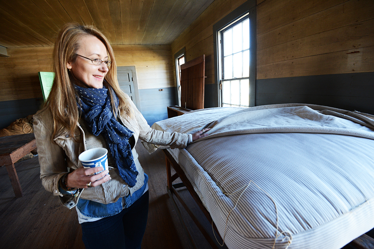 Cheryl, with one of the original old mattresses made in the factory back in the day.