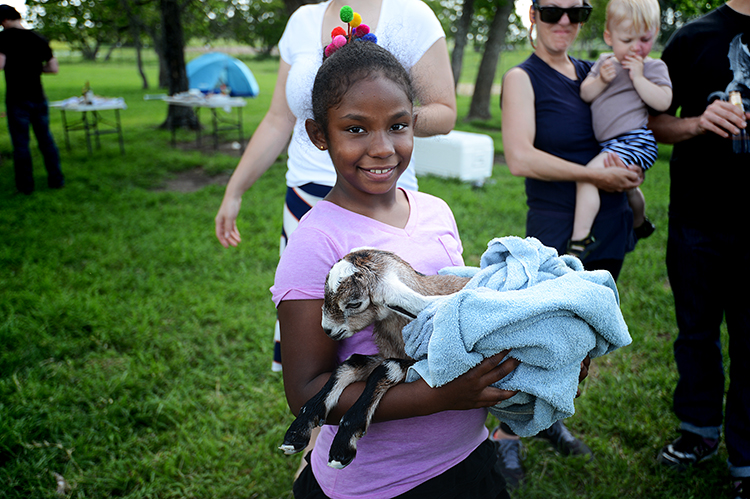 The little kid in this picture (the goat-kid, not the human-kid) is only about 15 minutes old.  (The human-kid is 9 years old).  The goat-kid's name is Benjy.  Her twin's name is Richard.  They're both girls.