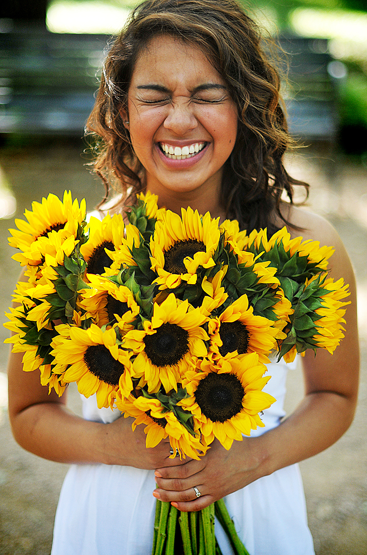 On a whim, I brought a bunch of sunflowers with me for the shoot.  It turns out that they're Maddy's favourite flower.   Score .