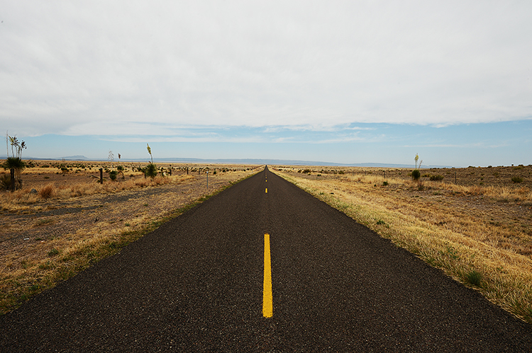 We drove hundreds of miles of roads just like this one -- usually just as deserted, allowing for photos to be taken right on the yellow line without fear of being run over.