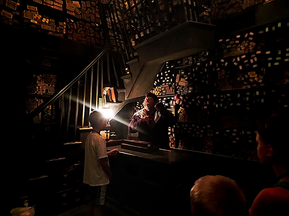 A young wizard gets his wand at Ollivander's Wand Shop.  Photo by Marcus.