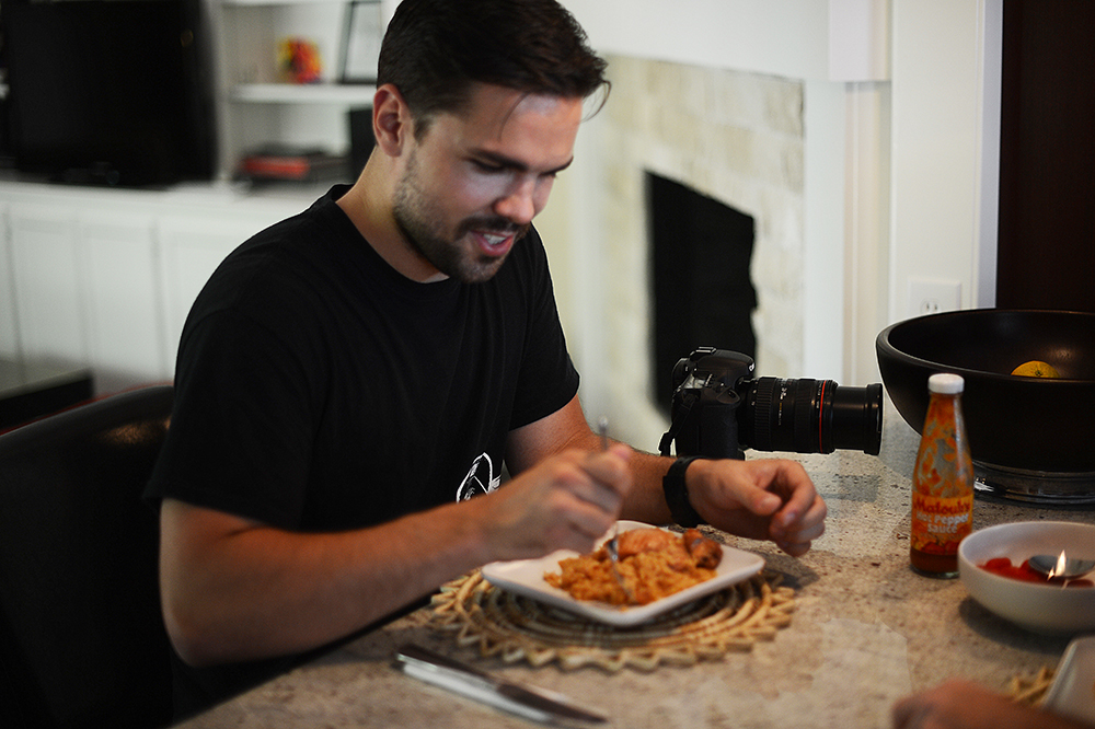 The very awesome cameraman behind my Untold Story video, Teddy Waffles, enjoying his plate of pelau.  He made me send the recipe to his girlfriend afterwards, so I'm taking that as a sign that he approved.
