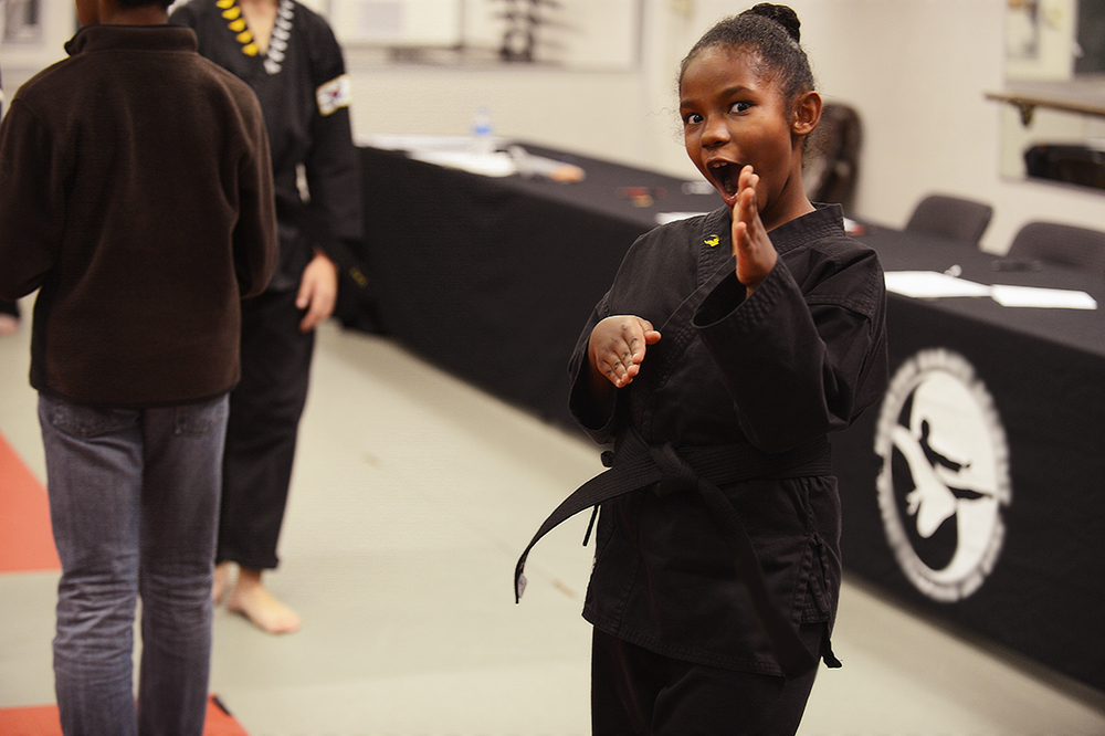 Giving me her best Bruce Lee in her brand new black belt.