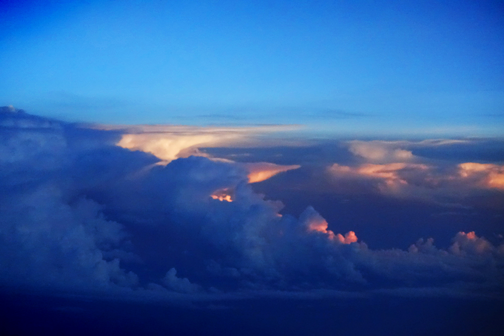 Thunderstorms somewhere between New York and Houston at sunset, August 18, 2015