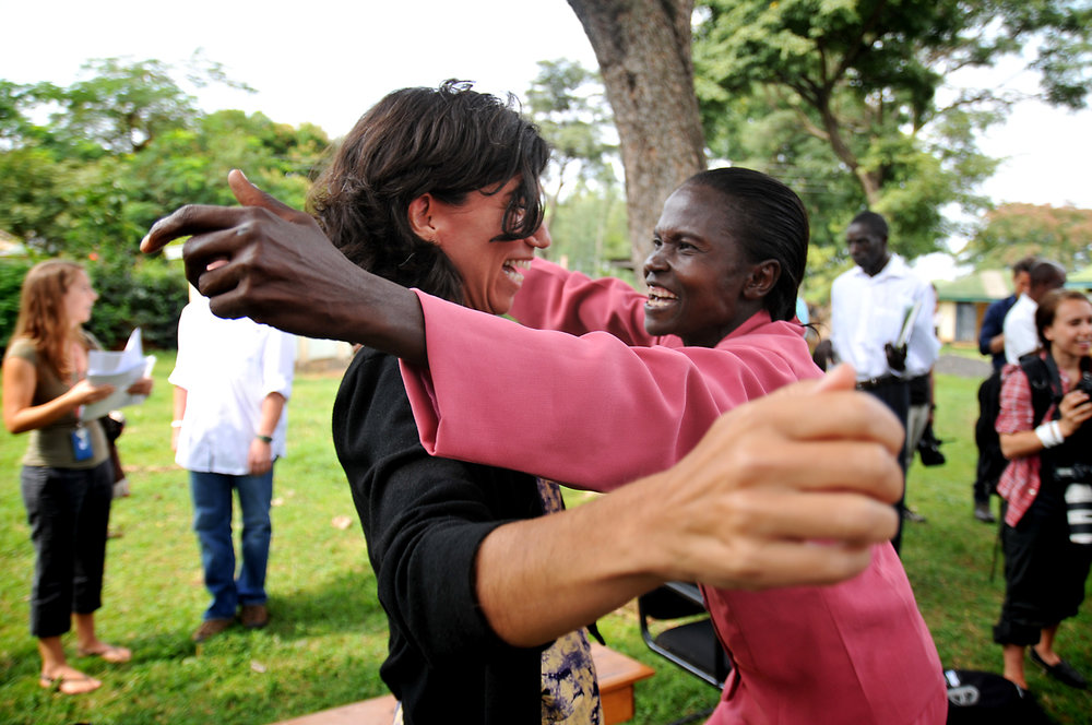 Friends greet each other in Kisumu, Kenya.