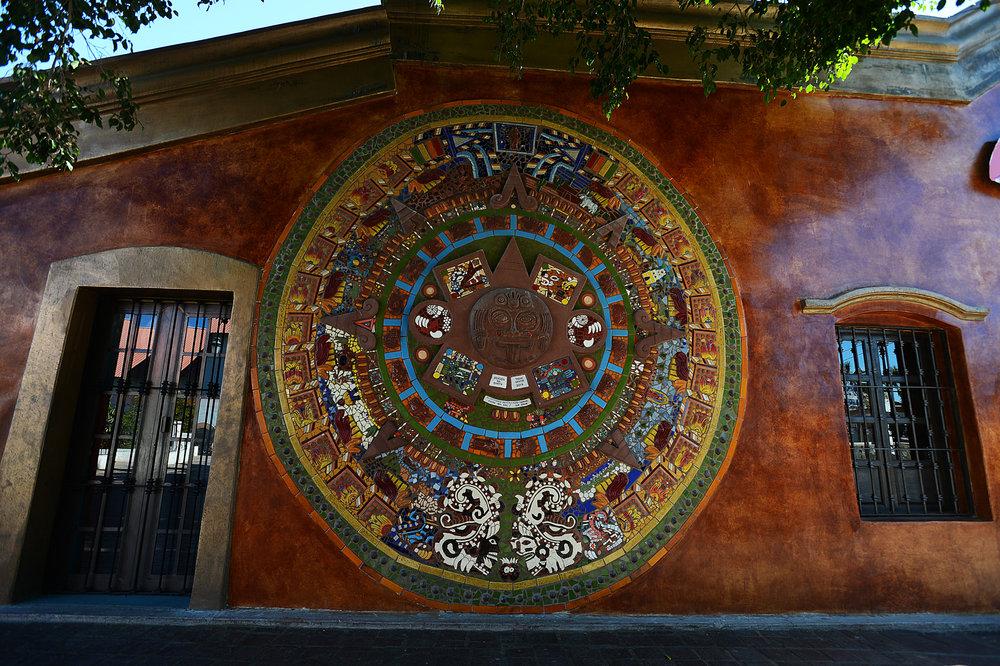 An artist's replica of the   Maya calendar  , on the exterior of a little downtown Todos Santos boutique.