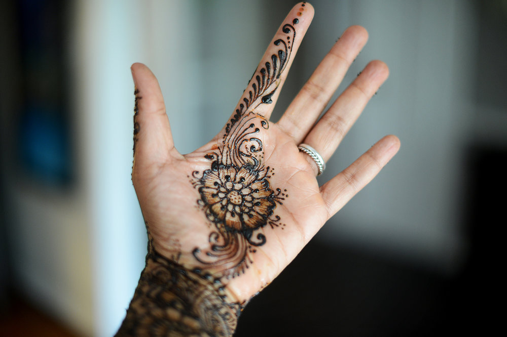 My henna'd hand (number 58). I actually now have henna done on important days — it's become a self-care tradition.