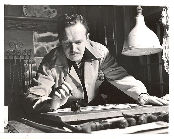 Alex Raymond at work in his studio.