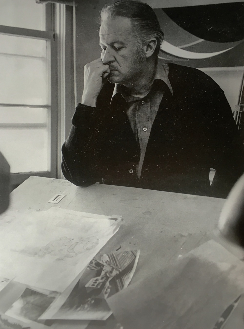 Ralph McQuarrie in his home studio, working on the pirate ship production painting (below), by Ed Summer.