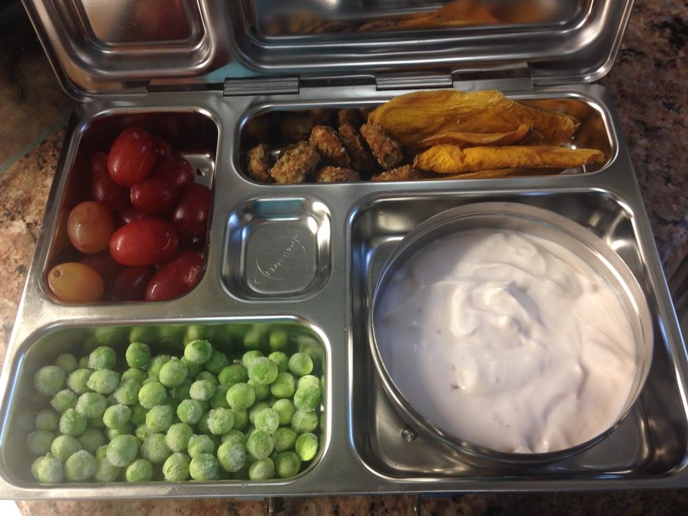 Cherry yogurt, frozen peas, grapes, dried mango, Somersault Snacks Pacific Sea Salt cookies