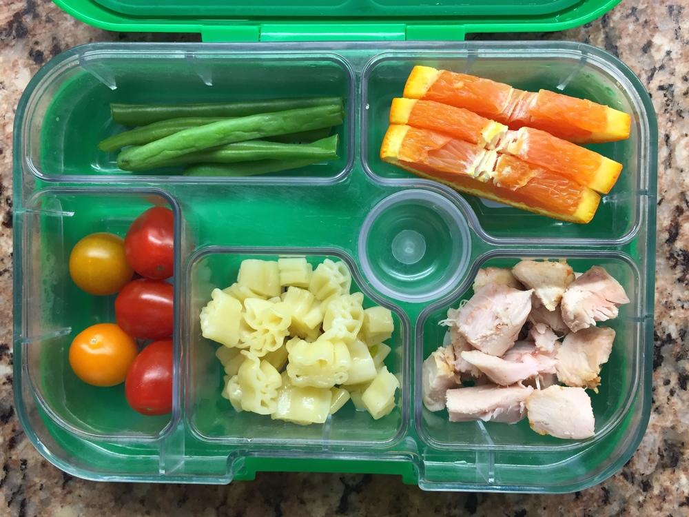 chicken, pasta, cherry tomatoes, green beans, orange