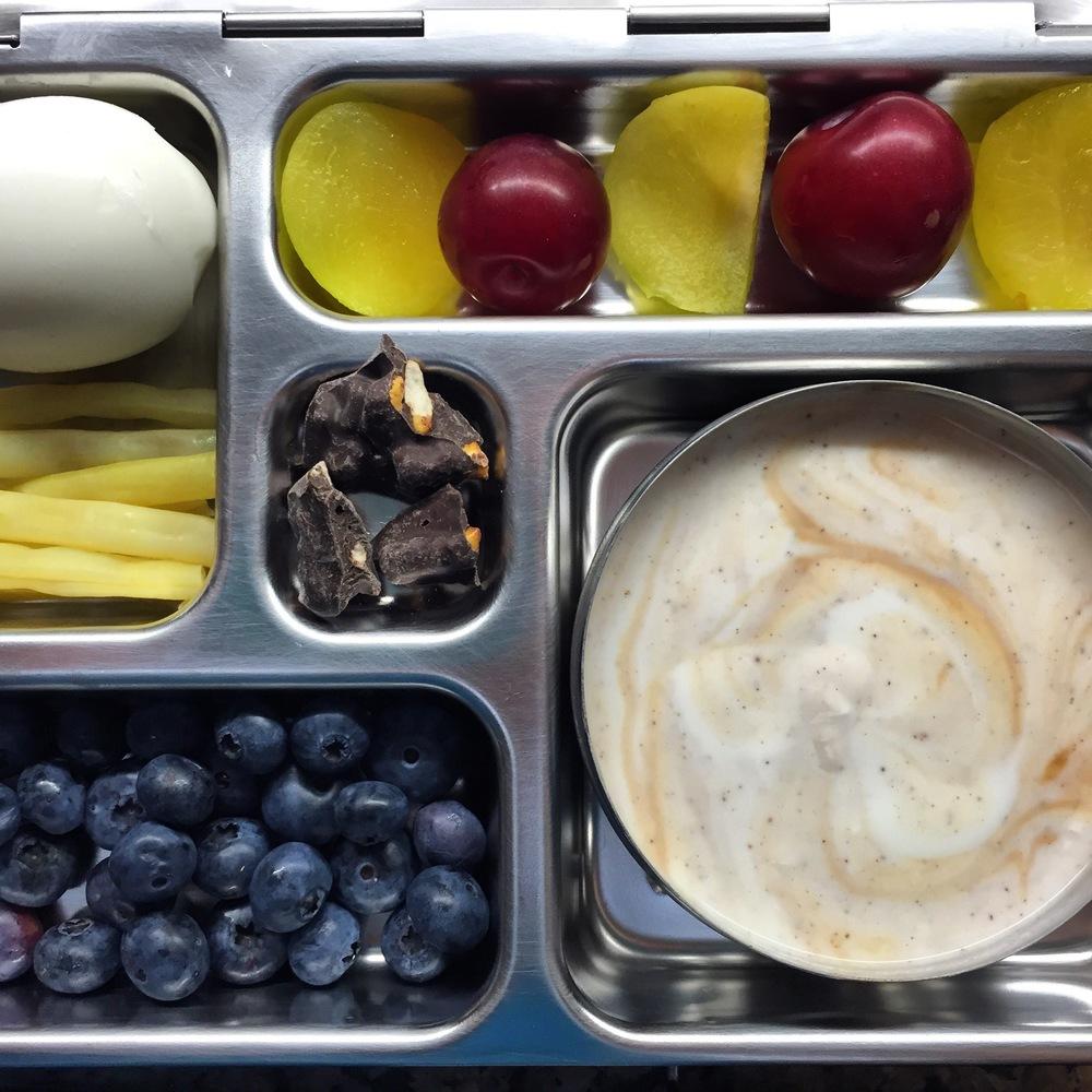 yogurt with honey and vanilla, blueberries, wax beans, egg, sugar plums, dark chocolate with pretzel