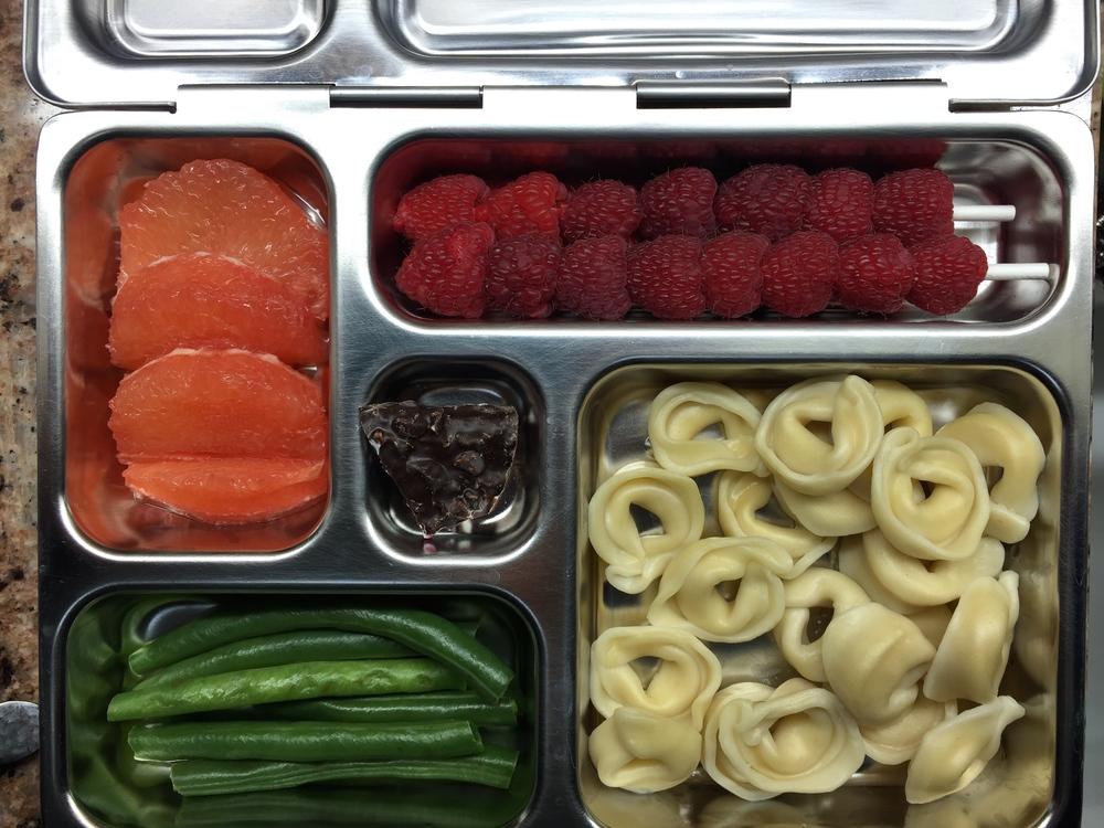 Cheese tortellini, green beans, grapefruit, raspberries, dark chocolate with mint.
