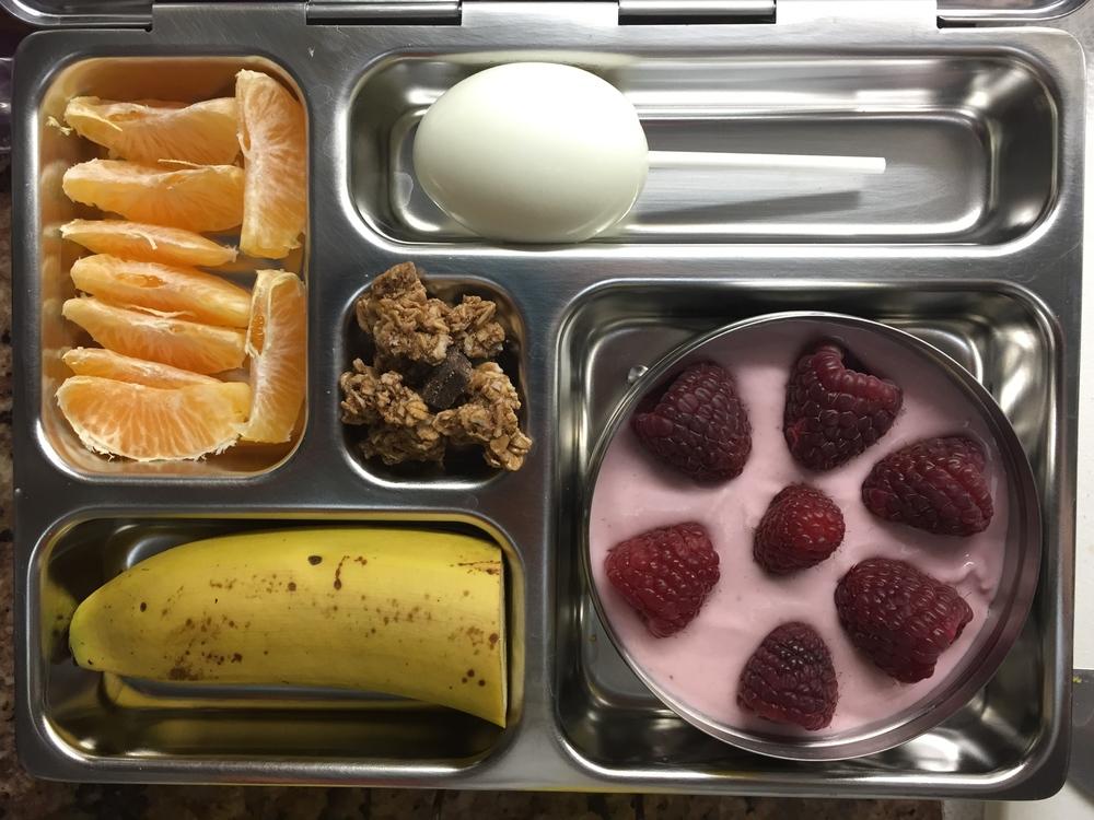 Yogurt with raspberries, egg, clementine, banana, granola.