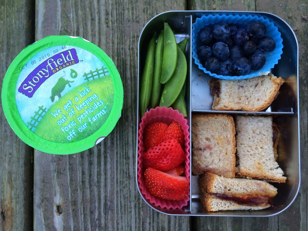 PBJ by request of her 2nd grader. Plus sugar snap peas, strawberries, blueberries, and a raspberry yogurt.