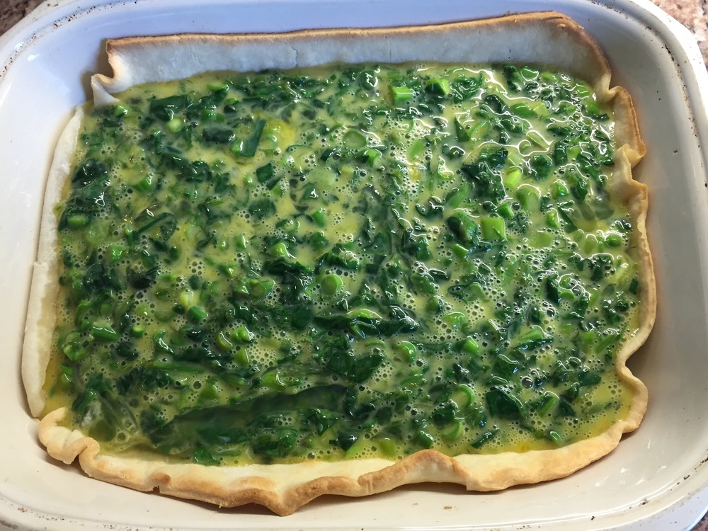 eggs + greens + crust = ready for the oven!