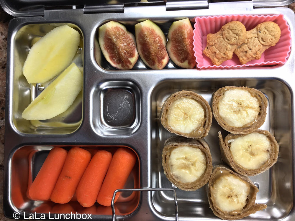 banana sunflower seed roll ups, carrots, apple, figs and cookies.