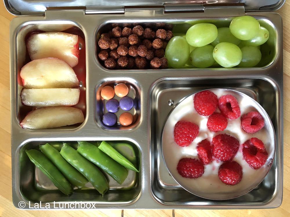 DIY yogurt parfait: yogurt, berries and cereal, plus grapes, nectarine, snap peas and a sweet chocolate treat.