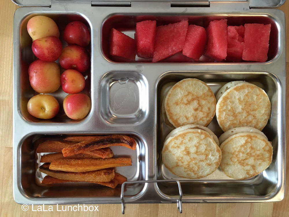 pancake sandwiches with sunflower seed butter, watermelon, cherries and carrot fries.