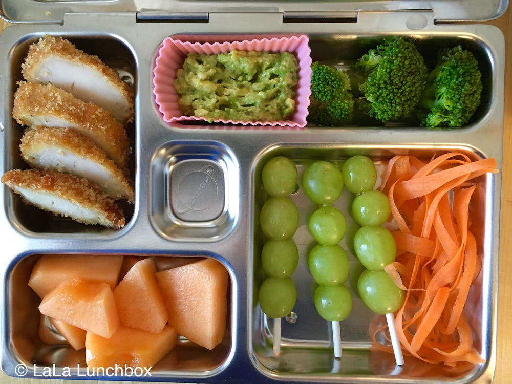 leftover chicken cutlet, guacamole, broccoli, carrot ribbons, grapes and cantaloupe.