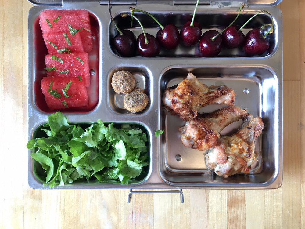 Leftover chicken drumettes, cherries, watermelon with mint, salad, sunflower seed cookies