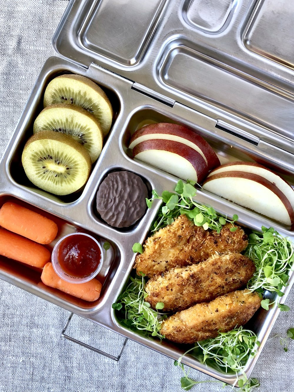 homemade dairy free chicken tenders in a lunchbox